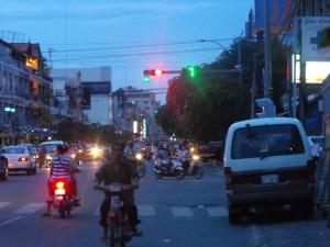 Motor bike on wrong side of road.
